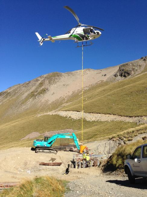 Helicopter bringing in concrete for the Triple Chair columns