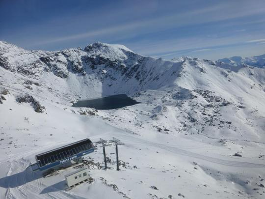 Aerial view of the Curvey Basin top terminal at The Remarkables looking across to Lake Alta
