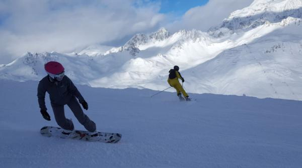 Snowboarder and Skier Tignes